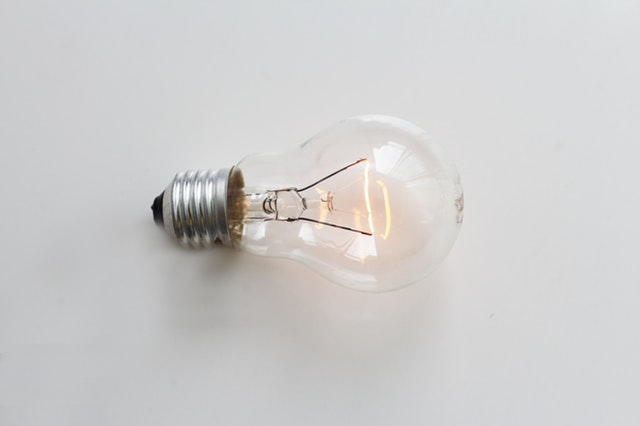 Light bulb sitting on a white background