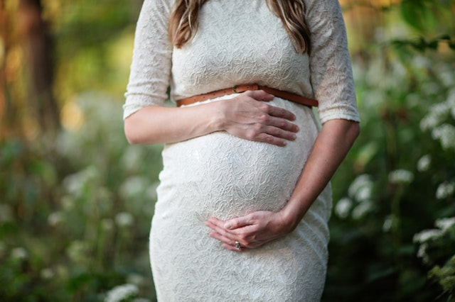 Pregnant woman standing outdoors in a Canberra park